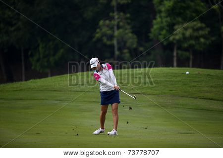 KUALA LUMPUR, MALAYSIA - OCTOBER 11, 2014: So Yeon Ryu of South Korea  makes a shot from the fairway of the ninth hole of the KLGC Club during the 2014 Sime Darby LPGA Malaysia golf tournament.