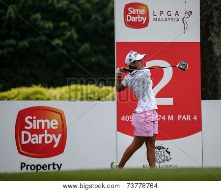 KUALA LUMPUR, MALAYSIA - OCTOBER 11, 2014: Julieta Granada of Paraguay tees off at the second hole of the KL Golf & Country Club during the 2014 Sime Darby LPGA Malaysia got tournament.