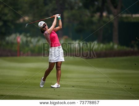 KUALA LUMPUR, MALAYSIA - OCTOBER 10, 2014: Park Hee Young of South Korea plays on the fairway of the ninth hole of the KL Golf & Country Club at the 2014 Sime Darby LPGA Malaysia golf tournament.