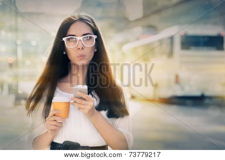 Surprised Young Woman Holding Smartphone and Coffee Cup