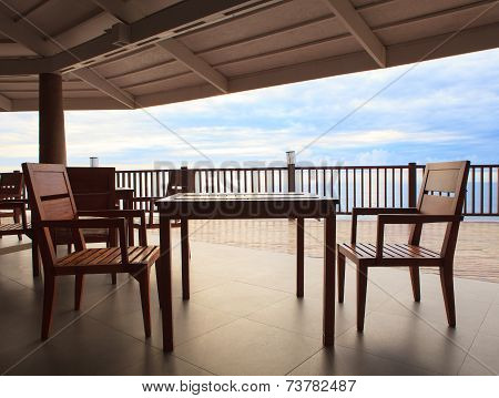 Wood Table And Wooden Desk In Pavilion Terrace Against Beautiful Sky At Sea Side Location