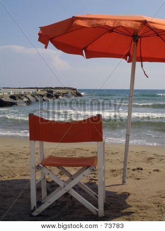Chair And Umbrella On Beach