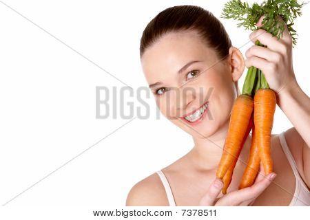 Chica con zanahorias