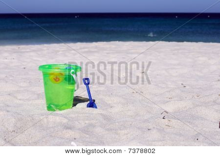 Baby Bucket On A Sandy Beach