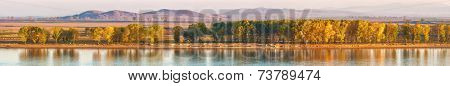 Danube in autumn fall. Beautiful and wild panoramic landscape nearest Danube Delta. Macin mountains in background.