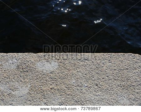 Texture Of Blue Water And Grey Cement
