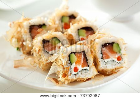 Bonito Maki Sushi - Rolls with Fresh Salmon, Cucumber, Cream Cheese and Salmon Roe inside. Dried Shaved Bonito outside