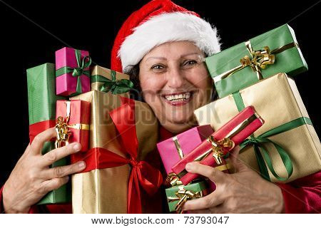 Cheerful Aged Woman Embracing Wrapped Presents .