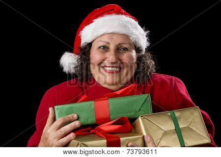 Delighted Elderly Woman Hugging Three Wrapped Gifts.