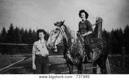Vintage women  in 1946 with horses