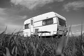 picture of caravan  - caravan camping with table and two chairs - JPG