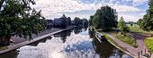 image of barge  - Narrow boat barge under the green trees in Cambridge UK - JPG