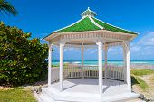 picture of gazebo  - A gazebo or pavilion with hexagonal shape isolated with a green roof and opened by all the sides - JPG