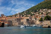 stock photo of marina  - A view across the marina at boats anchored in the harbor and the hillside surrounding the marina at Dubrovnik Croatia - JPG
