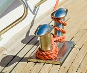 picture of bollard  - bollard docked yachts in the port is fixed rope - JPG