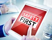stock photo of workplace safety  - Hands Holding Digital Tablet Safety First - JPG