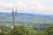stock photo of voltage  - High voltage towers on mountain High - JPG