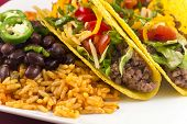 stock photo of jalapeno  - Mexican tacos with rice black beans and jalapenos  - JPG