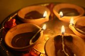 picture of pooja  - A  close up many earthen indian lamps in a brass plate - JPG