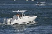 picture of outboard engine  - twin outboard engine powered small fishing boat cruising the florida intra - JPG