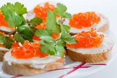 stock photo of collate  - Toast with red caviar butter and parsley - JPG