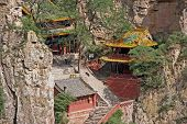 stock photo of impressionist  - beautifully decorated buildings of hengshan taoist monastery in Shanxi Province near Datong China stylized and filtered to resemble an oil painting - JPG