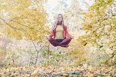 foto of levitation  - Levitation portrait of beautiful girl in the park - JPG
