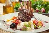 stock photo of lamb chops  - Roasted Lamb Chops with Risotto and Vegetables - JPG