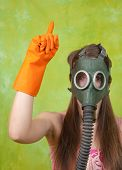 stock photo of global-warming  - girl in gas mask pointing ATTENTION - JPG