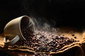 picture of coffee crop  - Coffee beans with smoke in coffee cup - JPG