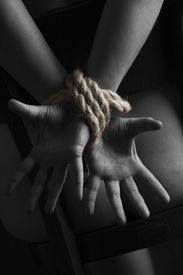 picture of sadism  - Nude submissive handcuffed woman - JPG