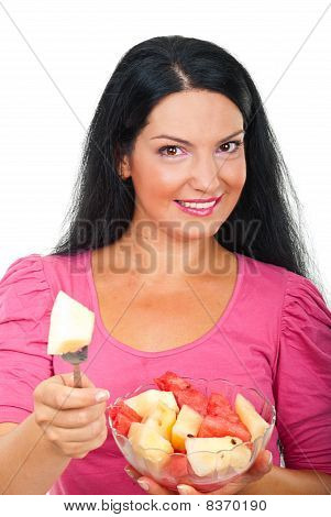Smiling Woman Giving A Piece Of Melon