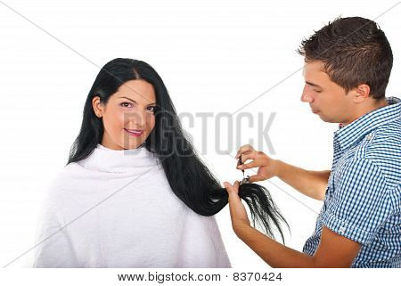 Hairstylist Cutting Long Woman Hair