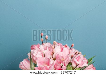 Close-up View Of Bouquet Of Pink Fresh Tulips With Pussy-willow Blue Background