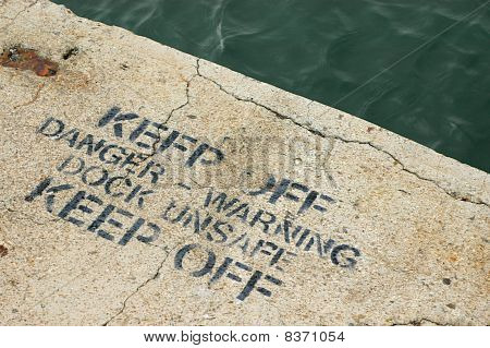 Warning Sign On An Unsafe Dock