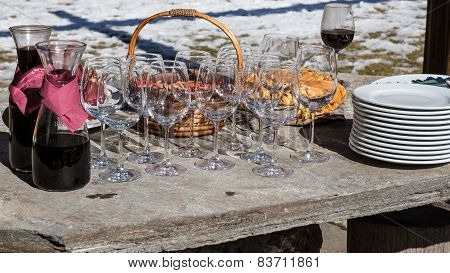 Red Wine In Jugs With Empty Glasses