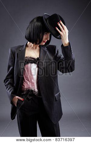 Hot lesbian brunette posing as elegant groom