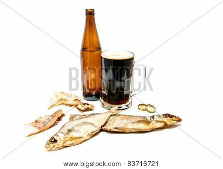 Salty Fishes And Glass Of Dark Beer On White