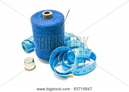 Spool Of Thread With Needle, Meter And Thimble
