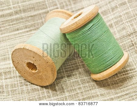 Wooden Spools Of Green Thread