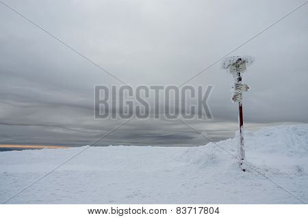 Gloomy Winter Landscape With Frozen Sign Showing Directions To Nearest Mountains,carpathians,Ukraine