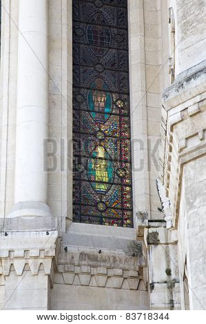 Lyon, France - February 19 2015: Virgin Mary Holding A Flowers In Her Hand On A Stained Glass Window
