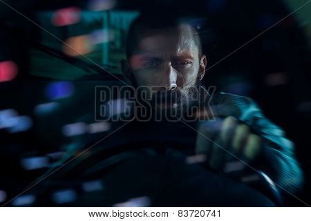 Man Driving Around The City At Night