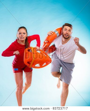 Lifeguards Running With Equipment