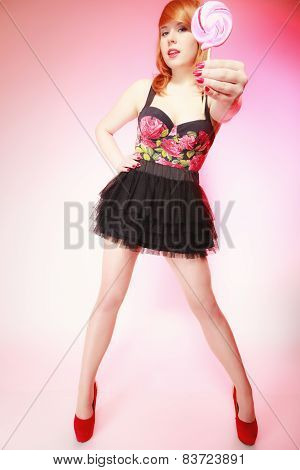 Redhair Girl Holding Sweet Food Lollipop Candy On Pink.