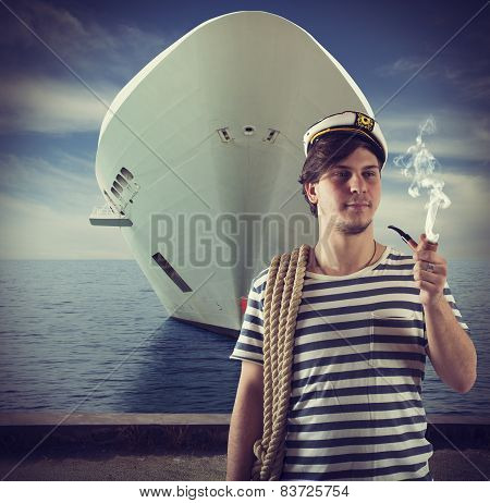 Sailor smokes in front of ship