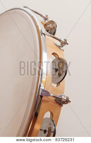 Vertical Tambourine On Beige Background