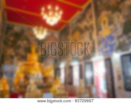 Natural Bright Blurred Background Of Gold Buddha Statue.