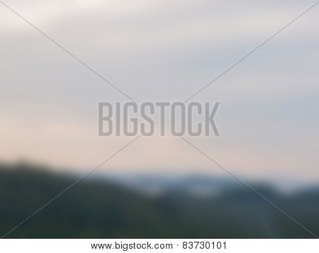 Natural Bright Blurred Background Of Sky And Mountain.