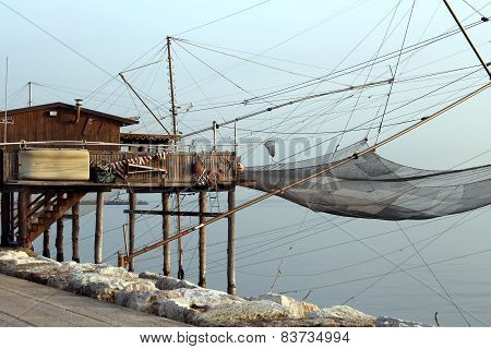 Large Stilt House By The Sea And Fishing Nets